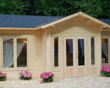 Check Out This Cute Cozy Courtyard Cabin Kit For $22,000